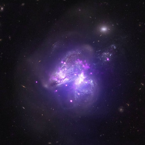 an image from nasas chandra x ray observatory shows two galaxies colliding 140 million light years